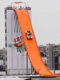 WOW! Tanner Foust makes every childhood dream come true, launching a hot wheels car down a ten-story drop and soaring 332 feet! See it to beleive it! #incredible #spon