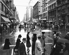Enduring the rain in downtown Los Angeles, circa 1940