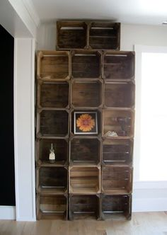 I had a request for an updated photo of the floor-to-ceiling apple crate shelves in our living room. This was the best I could do. We tem...