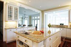 White cabinets, Venetian Gold Granite, dark hardwood floors, silver hardware. Love this!