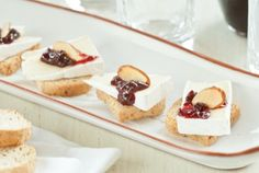 Brie and Sour Cherry Toast Bites  24 whole wheat mini toasts  1/2 (350g) wheel Isigny Ste. Mere Bonhomme Brie, cut into 24 pieces  1/2 cup Dalmatia Sour Cherry Spread  1/4 cup sliced almonds, toasted  -Top each mini toast with a piece of Brie and a dollop of cherry spread, then garnish with almonds and serve-  Makes 2 dozen