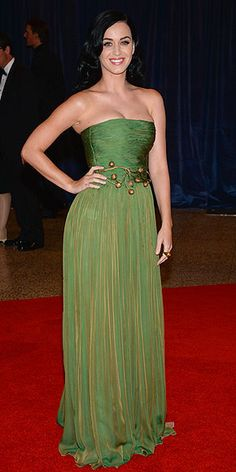 KATY PERRY at the White House Correspondents Dinner   made a statement in a green Giambattista Valli Haute Couture gown with a gilded belt, plus Adeler jewelry.