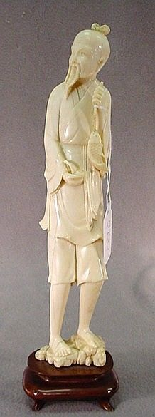 """Chinese carved ivory of a fisherman Chinese hand carved ivory figure of a fisherman w/wood base. 11 1/2""""H."""