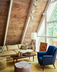 AMAZING A-FRAME HOMES: mid-century #modern living room with #natural lighting + #retro furniture: