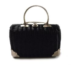 Classic Vintage Black Wicker Rattan Purse Bag Handbag Circa 1950s Hong Kong B.F.  From a rare estate sale that had over one hundred incredible vintage bags, purses, and accessories.  This bag is stunning in every way. Classic. Quality hardware. Very Good condition. Note: Has two interior pockets: Slip pocket, and a zippered pocket which does not close. Clean interior Woven or glazed wicker Hardware in very good condition. Some photos have reflections. Leather acting as hinges in very good…