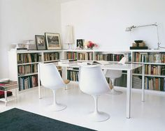 Love the low bookshelves framing the dining table.