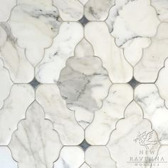 Ganesha, a natural stone waterjet mosaic shown in Calacatta Tia and Bardiglio with a venetian finish | New Ravenna