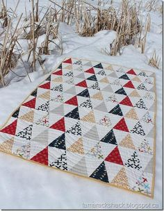 Triangle Quilt using Reunion fabric and Kona Snow | Tamarack Shack (she was able to cut 17 triangles out of each fat quarter)