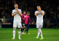 Dejected Chelsea players Gary Cahill and John Terry applaud the travelling fans following his team's 3-1 defeat during the UEFA Champions League quarter final, first leg match between Paris Saint Germain and Chelsea at Parc des Princes on April 2, 2014 in Paris, France