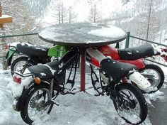 Repurposed old motorcycles into a creative table ... in Saas Fee in Switzerland