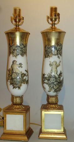 A pair of glass gilded lamps, Putti décor, circa 1940.