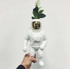 Cosmic Porcelain Astronaut Vase - The Cool Hunter