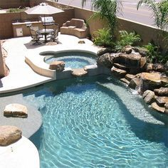 This is the story of how a homeowner decided to build his own swimming pool from the ground up to create an entire entertainment area in his back garden. The installation includes a gorgeous swimming pool with rock waterfall, and a splash pool, a braai area. - See more at: http://www.home-dzine.co.za/garden/garden-would-you-build-pool.htm#sthash.vFKUWC6d.dpuf