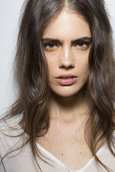 Add a touch of orange shadow to your next nude makeup look for a hint of color. #LFW