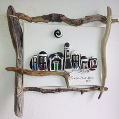 This wall piece is already SOLD! ORDER another one! An artistic architectural portrait inspired by common day-to-day situations, small animals, houses, couples and so many other nice things to see, to have and to enjoy, produced from driftwood, stones and any other type of material,