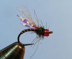 Chad's Mojo Midge uses purple haze Krystal Flash and a ruby bead head to give it some flash in deep or dark water.