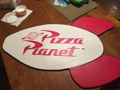 The Pizza Planet sign my husband made for Logan's Toy Story party! Www.thecutestboyintheworld.com  #thecutestboyintheworld