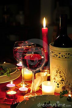 Red wine candlelight dinner by Simsonne, via Dreamstime