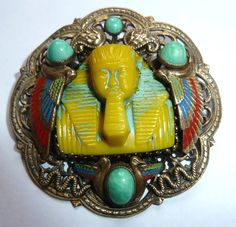 Egyptian Revival brooch with unusual colour glass centrepiece.  Not Max Neiger.  Photograph Gillian Horsup.