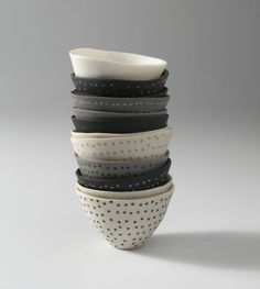 Mel Robson : Little Uns (polka dot), 2007, slipcast porcelain with inlay, 5cm x 7cm each