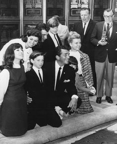 Today 3-21 in 1964, Dean Martin immortalized his hand and footprints in cement in the patio of Grauman's Chinese Theater in Hollywood surrounded by his family - L-R Gail, Ricci, Dean, Gina, Jeanne - Back row, Claudia, Craig, Dino.