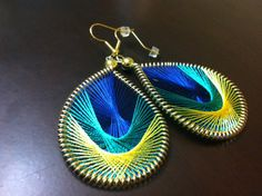 Peacock Feather Thread Earrings. I just realized I could DIY this...for the love of peacock!