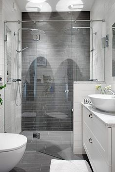 Bath - Grey tiles in an extraordinary two-person shower, the star of this room, is complemented by the Carrera marble countertop & white vessel sink. - Model Home Interior Design Gray And White Bathroom, Grey Bathrooms, Bathroom Renos, Basement Bathroom, Beautiful Bathrooms, Budget Bathroom, Bathroom Renovations, Bathroom Interior, Attic Bathroom