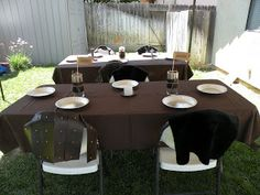 "Each place setting had a pie tin for a plate and a faux leather ""Astrid"" skirt or a fur ""Hiccup"" cape."