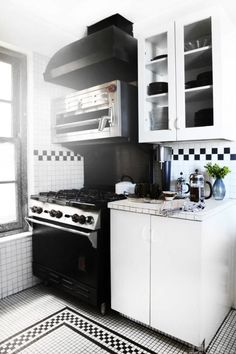 Jeweler Alexis Bittar's Brooklyn Heights kitchen gives off retro vibes thanks to its checkerboard tile work. The various patterns used add depth to the space. Tour the rest of the home here.   - ELLEDecor.com