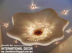 stretch ceilings in the interior of modern apartment, stretch ceiling with modern chandelier and spot light