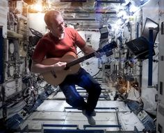 "In in the zero-gravity atmosphere of outer space, Canadian astronaut Chris Hadfield made history when he reached for a floating Larrivée parlor guitar to perform the early David Bowie hit ""Sp… Chris Hadfield, Major Tom, Leonard Peltier, Music Mix, David Bowie, What Is Like, Outer Space, Jukebox, Music Videos"