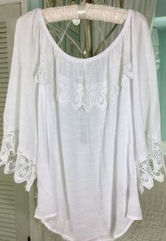 "~~Elastic Peasant Neckline. WHITE RUFFLE CROCHET LACE BLOUSE. ~~Rayon / Polyester. ~~3/4 Sleeves with Lace Trim. ~~Ruffle / Lace Detail at Neckline. ~~ 30"" Shoulder to Hem Length. 