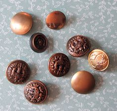Buttons  Metal colored 9 pcs. $3.20, via Etsy.