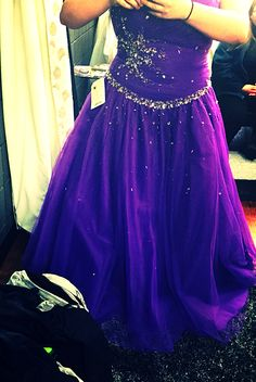 This is my corseted size 18 grad dress. I just love the purple that comes on it.