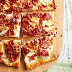 Chalk this recipe up as an occasional indulgence. Its topped with a totally mouthwatering combo of thin-sliced potatoes, bacon, sausage and a delectable garlic-rosemary butter. The recipe, which comes from Hidemi Walsh of Plainfield, Indiana, received an honorable mention in our 2012 Best of the Midwest Recipe Contest.