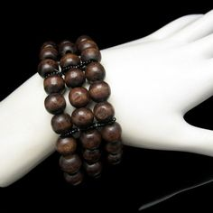 New in the #MyClassicJewelry @Etsy Shop! http://ift.tt/1rEdsaZ Extra Wide Vintage Bracelet Mid Century Wood Beads 3 Strands Stretch Warm Rich Brown Colors by MyClassicJewelry #GotVintage