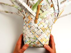 Woven Map Basket: Repurpose your old road maps.  The tutorial is here:  http://makeprojects.com/Project/Woven-Map-Basket/75/1