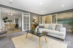 open plan, homestead, upholstered sofa, woven rug, bush setting, neutral tones, layers, texture