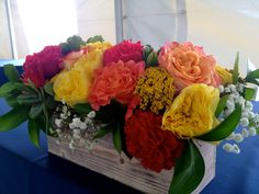 Head table flowers in a rustic wooden box.  www.the-petal.com