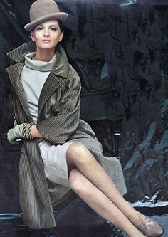 Another famous 60s name in American fashion: Adele Simpson. She made smart clothes. Case in point: This wide-whaled corduroy coat in olive over a pale wool dress with a loose cowl neck. Bracelets by Tiffany; ghillies (lace-up shoes) by Evins; hat by Emme. You could so wear this outfit today. Photo from Vogue, September 1963. white sheath shift dress