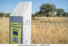Saceruela, Spain - September 2nd, 2017: Granite sign post on Guadalupe Pilgrimage way at Saceruela outskirts, La Mancha Region, Spain