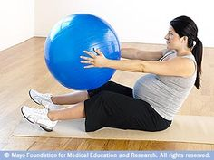 Torso rotation with fitness ball can help with upper back stretches-don't forget a towel to sit on for support.