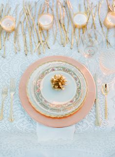 winter table setting with gold pinecones and twigs