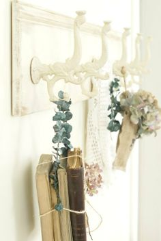 I love everything by Post Road Vintage.  This shelf (mostly the hooks) is so pretty.