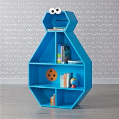 Shop Sesame Street Cookie Monster Bookcase. Our exclusive Cookie Monster Bookcase includes storage cubbies at the top and bottom and a large shelf in the middle, with varying compartment sizes for easy organization.