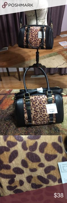 NWT Liz Claiborne Cheetah Satchel This is a gorgeous NWT Liz Claiborne Cheetah Satchel.  It has handles and a shoulder strap so that it can be carried whichever you prefer. Liz Claiborne Bags Satchels
