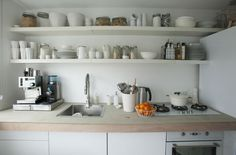 Open storage above the kitchen sink and work surface is useful