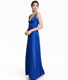 Cornflower blue. Maxi dress in satin with an open back and narrow shoulder straps tied at back. Wrapover V-neck, seam below bust, straight-cut, draped skirt
