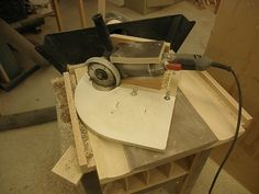 Chair Seat Carving Jig by Lola Ranch -- Homemade chair seat carving jig constructed from wood, plywood, hinge, and hardware. Intended for utilization with an angle grinder fitted with a sanding disc. http://www.homemadetools.net/homemade-chair-seat-carving-jig