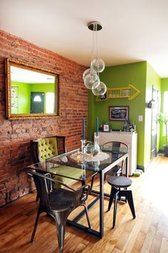 More Greenery, more exposed brick! Here, the hue is on an accent wall and upholstery to really add freshness to the space.